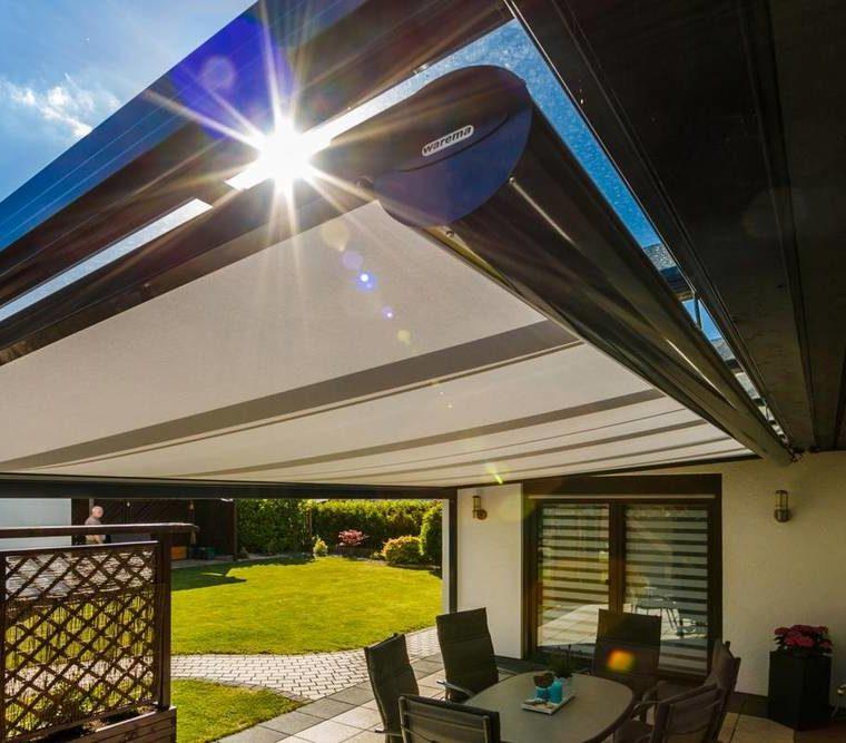Terrassenüberdachung mit Warema Markise als Sonnenschutz